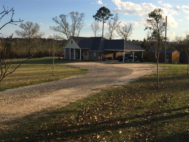 Beautiful home on 40 acres w pond ranch for sale for Fishing camps for sale in mississippi