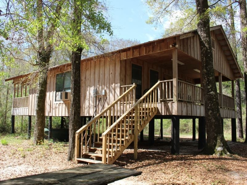 Rustic cabin on 236 acres in pearl ranch for sale for Fishing camps for sale in mississippi