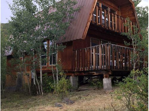 Cabin CO Creek Borders National : Mesa : Colorado